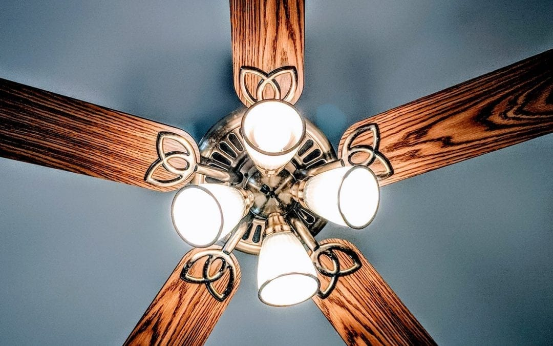 An upwards shot of a ceiling fan.